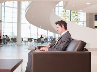 Businessman working in office waiting area