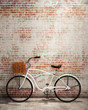 retro hipster bicycle in front of the old brick wall, background - 74079163