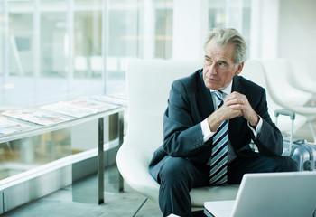 Businessman using laptop while traveling