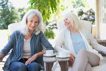 Senior women drinking coffee on patio