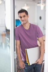 Smiling businessman in doorway