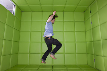 Man dancing in padded room