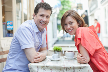 Couple together in cafe