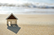 Leinwanddruck Bild - house on the sand beach near sea