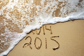 Happy Near Year concept 2015 replace 2014 on sea beach