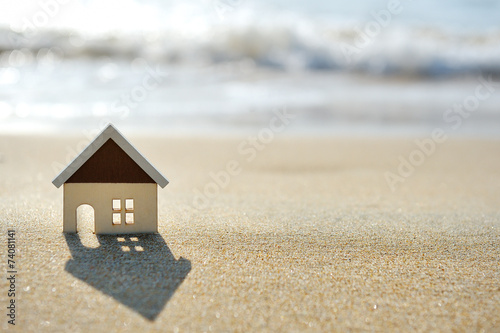 Foto op Canvas Strand house on the sand beach near sea