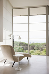 Chaise lounge chair near windows