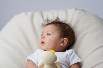 A baby playing with toy