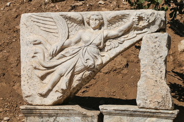 Sculpture of the god Nike in ancient roman city Ephesus, Turkey