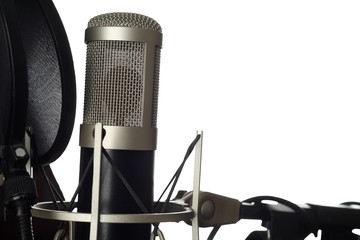 Studio microphone with pop filter close-up. Isolated