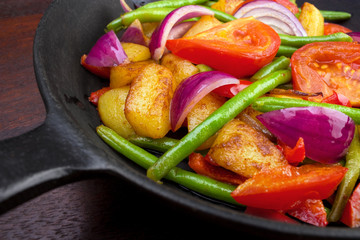 Cooked vegetables on frying pan closeup