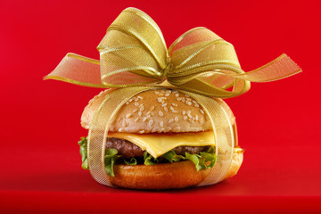 Gift wrapped hamburger , conceptual food image