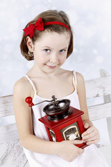 Little girl with coffee grinder