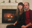 A Couple in Front of a Fireplace at Christmas
