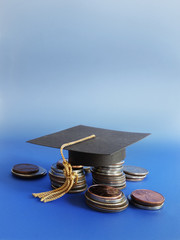 grad cap and coins