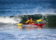 Kayak surfing on rough sea