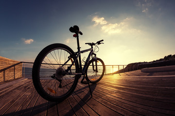 silhouette of mountain bike at sunset