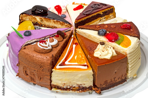 Different pieces of cake on a plate - 74088566