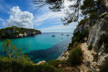 narrow path on sea cliffs  blue sea and yachts, Menorca