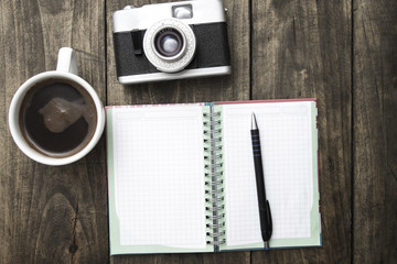 Vintage camera, diary with pan and cup pf coffee