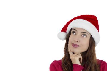 Christmas woman thinking and looking upwards hopefully