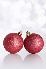 Two Christmas balls on abstract background