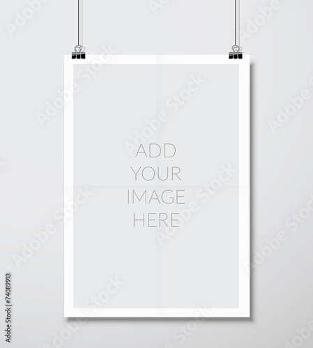Fototapeta Empty A4 sized vector paper frame mockup hanging with paper clip