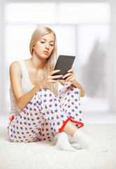Blonde woman with e-book