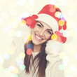 Happy young Christmas woman. Bokeh light effect