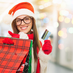 Christmas woman with credit card and shopping bags