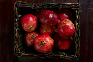Basket of red pomegranates