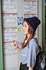 Asian woman at bus stop