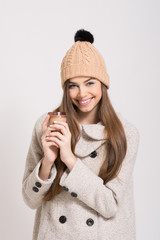Teenage girl with beanie hat and takeaway coffee. No retouch.