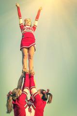 Cheerleaders in action on a vintage filtered look