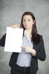 Businesswoman pointing on the paper