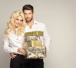 Beautiful young couple with presents