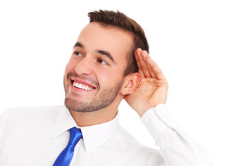 Happy businessman listening to something