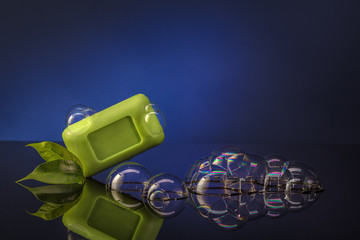 green soap bubbles on a blue background