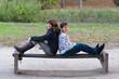 Teenage boy and girl having fun in the park on beautiful autumn