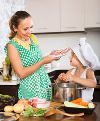 Mother with daughter cooking