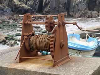 Rusty winch with fisherboats in Brandon Creek