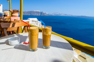 Ice coffee (frape) at balcony view view on caldera