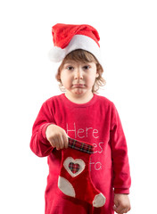 Funny little child holding empty Christmas sock