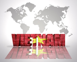 Word Vietnam on a world map background