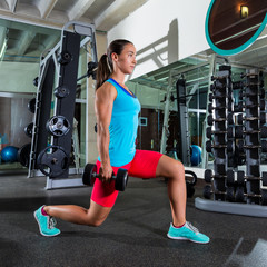 dumbbell lunge woman exercise at gym