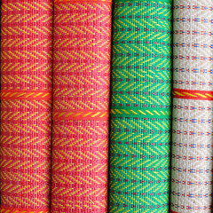 Colorful Thai mat stacking, for web background.