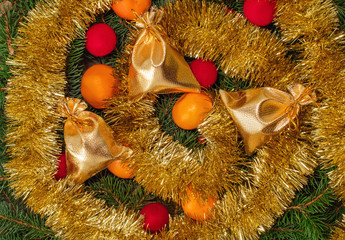 tinsel, gift bags, tangerines and spruce branches