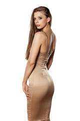 Back view of elegant young woman posing on white background