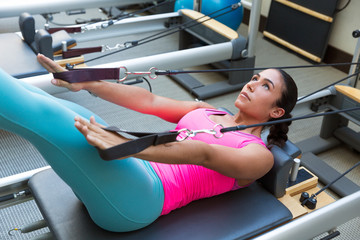 Pilates reformer workout exercises woman