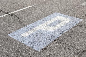 Parking sign on asphalt
